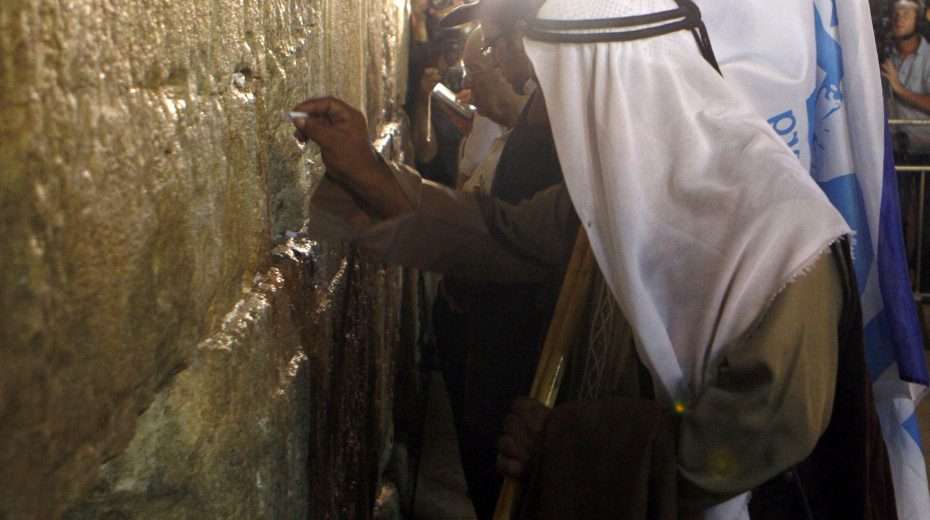 An Arab man prays at the Western Wall for the return of Israeli soldiers.