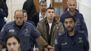 One Palestinian Kills, Another Rescues