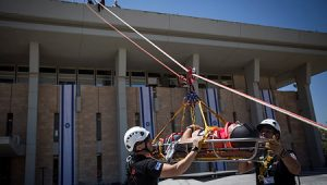 Members of the Knesset Honor Guard, Home Front Command, firefighters, IDF, Israel Police and Israel's Magen David Adom Emergency Medical Services participate in an drill simulating anearthquakeat the Knesset.