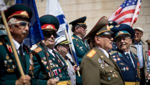 Russian-Israeli World War II veterans take part in the Veterans Day parade in honor of the Allies' victory over Nazi Germany, in Jerusalem on May 14, 2019.