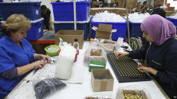 Palestinians and Jaws work at a SodaStream factory.