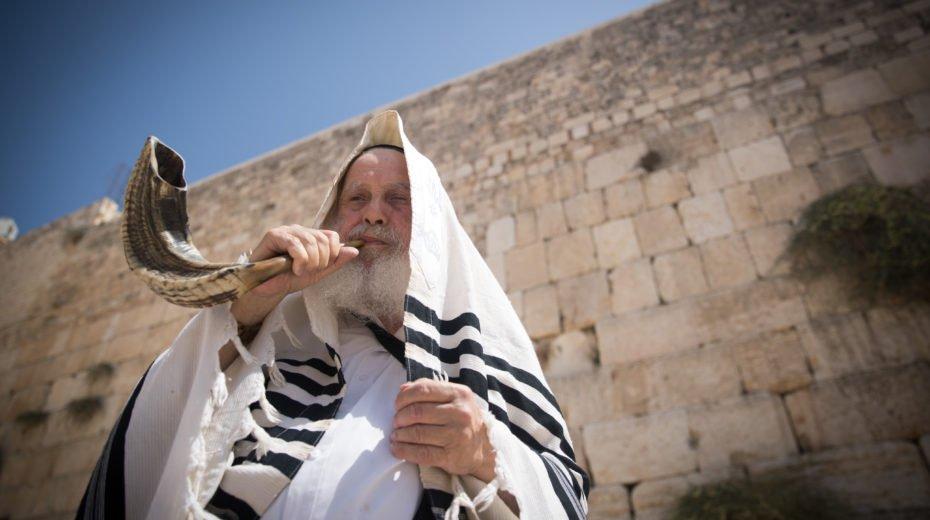 Sounding the shofar on Rosh Hashanah.