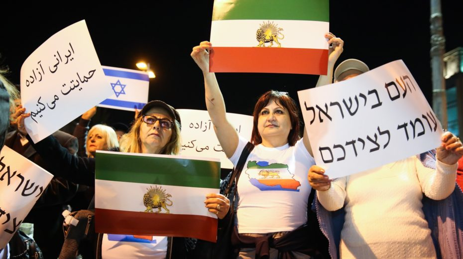 Demonstrators in Israel stand together with the people of Iran.