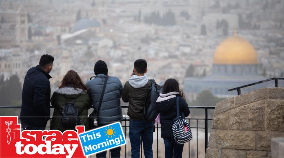 Israelis visit the Mount of Olives in Jerusalem during the winter storm.