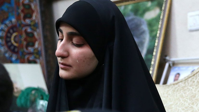 Zeinab Soleimani at a memorial for her father.