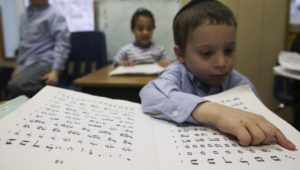 Israeli children today learn Hebrew, but it could just have easily been French or English.