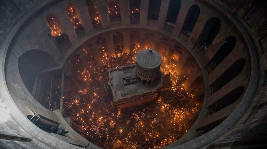 Christian worshippers participate in the ceremony of the Holy Fire in Jerusalem.