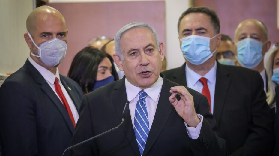 Netanyahu arrives at court for the opening of his criminal trial.