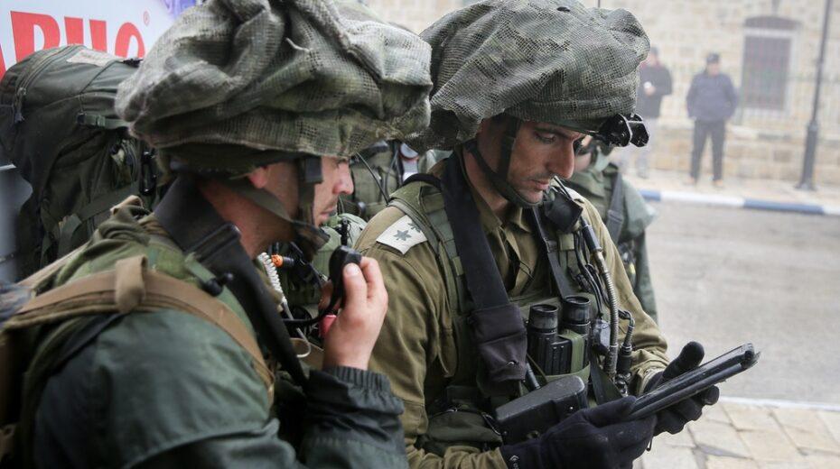 Israeli soldiers help Palestinian man.