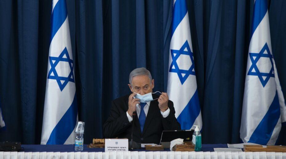 Netanyahu sits alone.