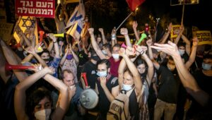 Left-wing Israelis protest outside Netanyahu's residence in Jerusalem.