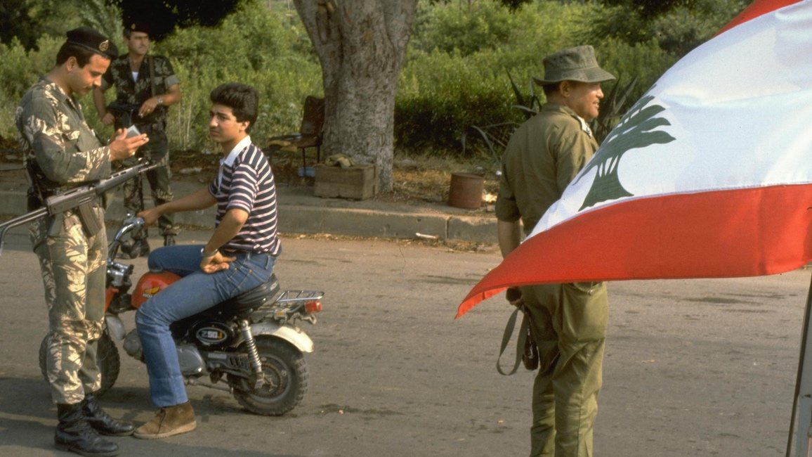 Lebanese Christian soldier mans a checkpoint with an Israeli soldier in 1983.