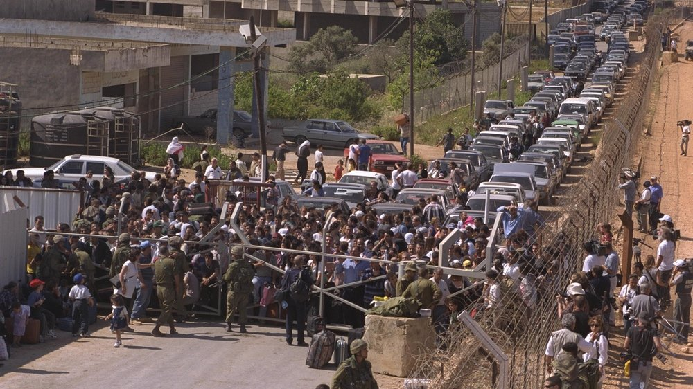 SLA soldiers and their families flee to the Israeli border in May 2000. Israel's sudden withdrawal left many Lebanese Christians angry and confused.