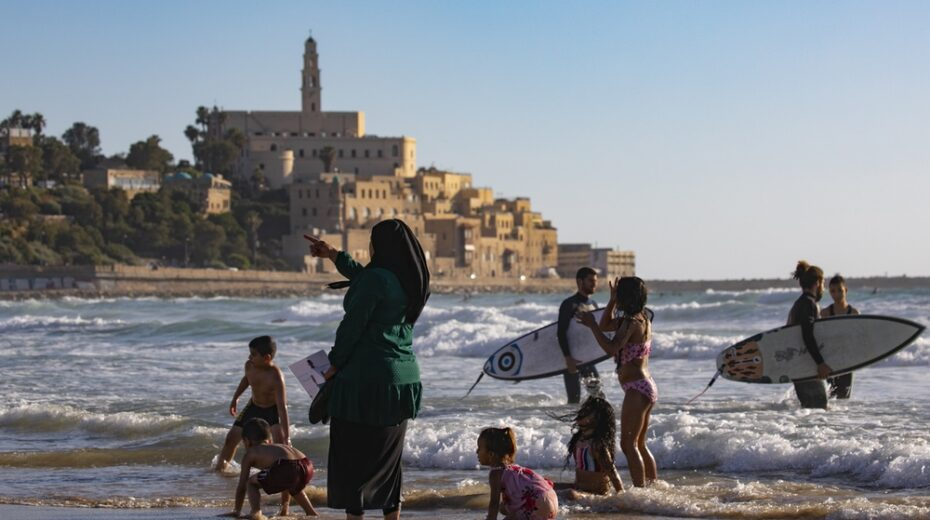 Palestinians enjoy a day at the beach in Tel Aviv.