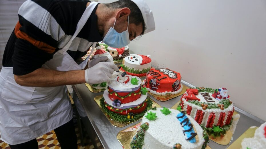 Palestinian chefs prepare holiday-themed cakes complete with coronavirus