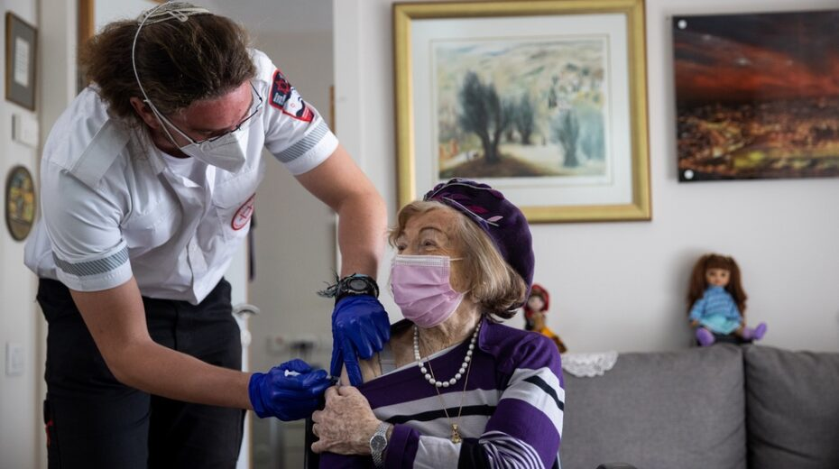A Holocaust survivor in Jerusalem is vaccinated against COVID.