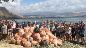 Christian volunteers pick up trash around the Sea of Galilee