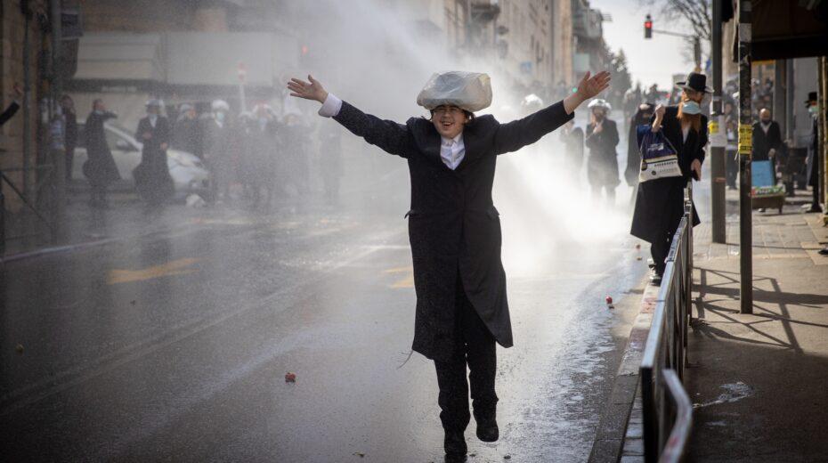Orthodox Jews clash with police near Tel Aviv.