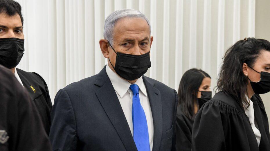Netanyahu looking pensive as he enters court