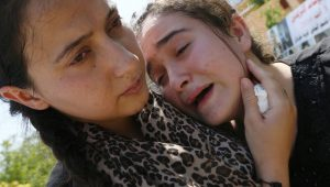 Yazidi victims of ISIS brutality mourn the massacre of their people