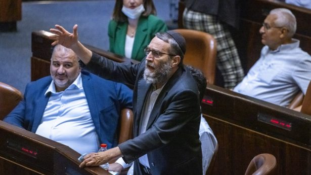 Ultra-Orthodox MK Moshe Gafni loudly protests what he insists is an anti-religious government, while an unimpressed Mansour Abbas, head of the coalition's Islamist faction Ra'am, looks on.