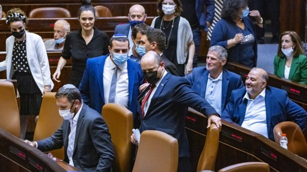 Among friends, surrounded by foes. But who's who? Prime Minister Naftali Bennett navigates stormy waters as he leads his coalition into the Knesset.