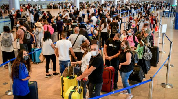 The Israelis are coming! Travelers seen in the departure hall at the Ben Gurion International Airport as Israel opens the skies for outbound summer holiday travel, on July 19, 2021.