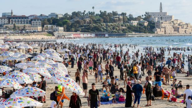 Muslims enjoy the sea by Tel Aviv during the third day of Eid al-Adha, on July 22, 2021. Muslims around the world are celebrating Eid al-Adha, the Festival of Sacrifice, to mark the end of the hajj pilgrimage.