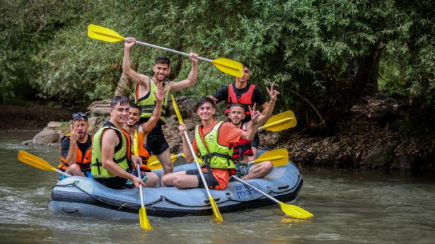 Young people enjoy kayaking in the Jordan river in Northern Israel on July 23, 2021.