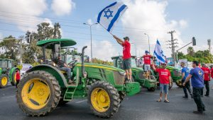 Israeli farmers block Bilu Junction in central Israel to protest the influx of foreign produce.