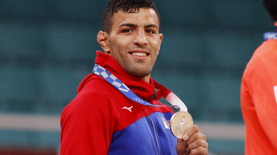 Iranian defector and champion judoka Saeid Mollaei wins his first Olympic medal and dedicates it to Israel.