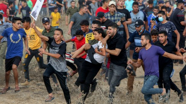 Palestinian protesters clash with Israeli forces during a protest at the Israel-Gaza border, east of Gaza City, on August 21, 2021.