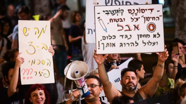Many Israelis protest the government's vaccination and Green Pass policies. Sign reads: Cognitive dissonance – the vaccine is safe and effective - BUT - doesn't protect at all and can kill you!