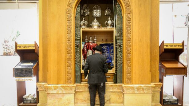 """Jewish man praying at the Cave of the Patriarchs in the """"West Bank"""" city of Hebron on August 26, 2021"""