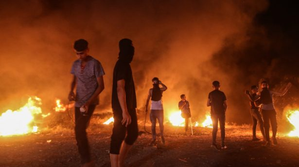 Palestinians protest at night time near the border with Israel, east of Gaza City, on August 28, 2021.