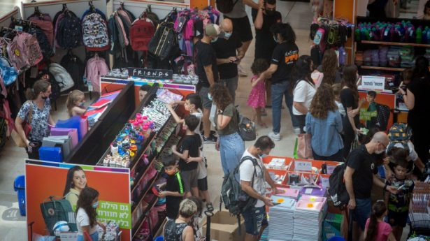 Israelis wear protective face masks as they shop for school supplies ahead of the upcoming school year, in the Givatayim shopping mall, on August 22, 2021.