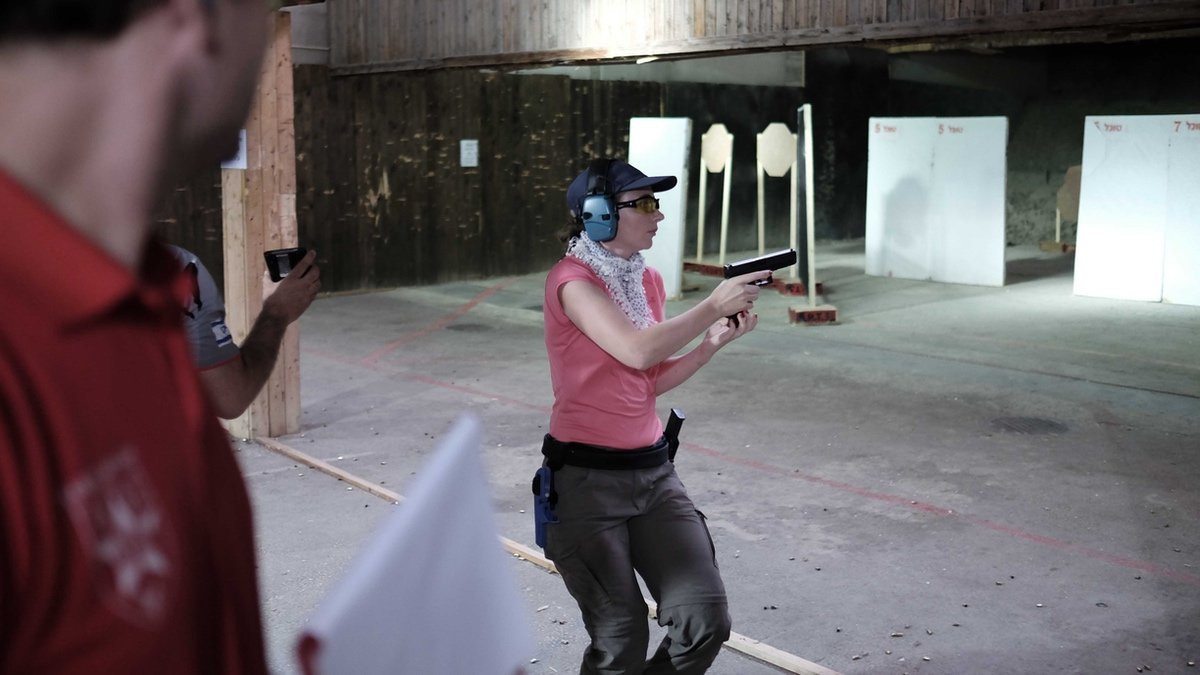 Israeli woman at a shooting range in Herzliya. Contrary to popular belief, most Israelis don't own a gun.