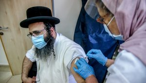 An ultra-Orthodox man receives the coronavirus vaccine in Jerusalem.