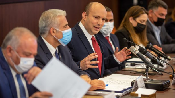 Back on track? Prime Minister Naftali Bennett celebrates cabinet approval of a state budget for the first time in three years. But the reform-focused budget must now pass three votes in a divided Knesset, otherwise it's new elections.