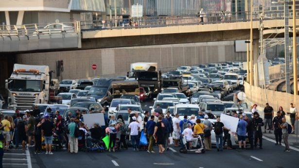 Disabled and handicapped Israelis block the Ayalon Highway in Tel Aviv as they attend a protest calling for better health care.