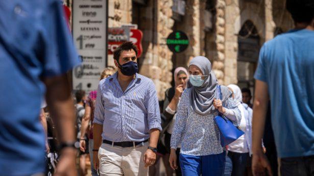 Face masks are back in fashion! Pedestrians in Jerusalem.