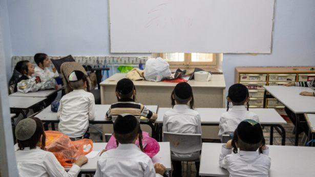 Ultra-Orthodox Jewish kids study on the first day of school at an ultra-Orthodox school in Jerusalem.