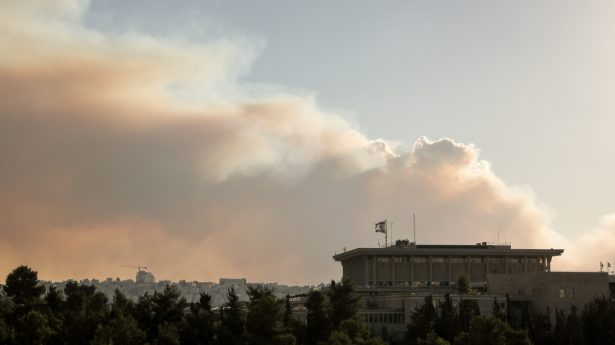 The fires were to the west of Jerusalem, but smoke filled the skies over the capital. In the foreground, the Israel Knesset.