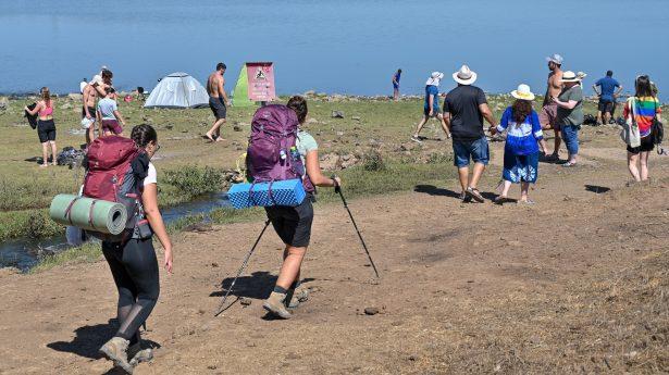 Israelis enjoy the water at the Merom Golan Water Reservoir during the Sukkot holiday.