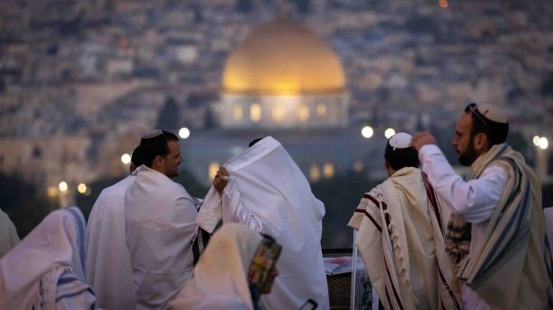 Sukkot prayers atop the Mount of Olives overlooking the Temple Mount in Jerusalem.