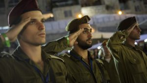 Has Israel started handing out the New Testament to recruits being sworn-in?